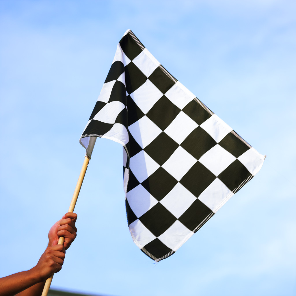 Image of a checkered flag, indicating the finishing line.